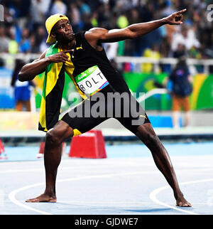 Usain Bolt (JAM) with his gold medal for winning the Men's ...