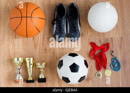 sports balls, boots, cups, whistle and medals - Stock Photo