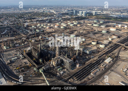 El Segundo, California, USA - August 6, 2016:  Aerial view of large steaming oil refinery near Los Angeles. - Stock Photo