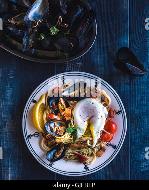 Fresh cooked mussel with spaghetti and boiled egg,selecctive focus - Stock Photo