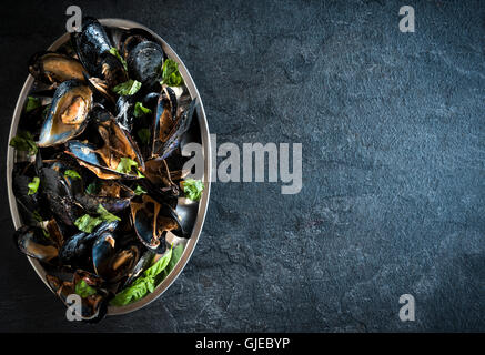 Cooked mussels in the plate,empty space - Stock Photo