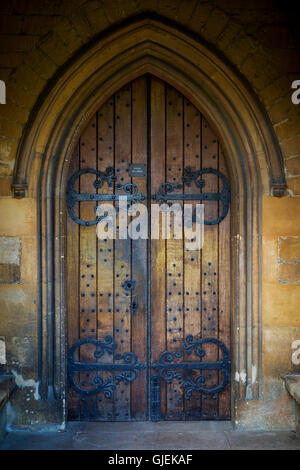 Wooden door entry to Saint Edwards Parish Church, Stow-on-the-Wold, Gloucestershire, England - Stock Photo