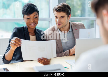 Creative group of young people brainstorming on meeting in office - Stock Photo
