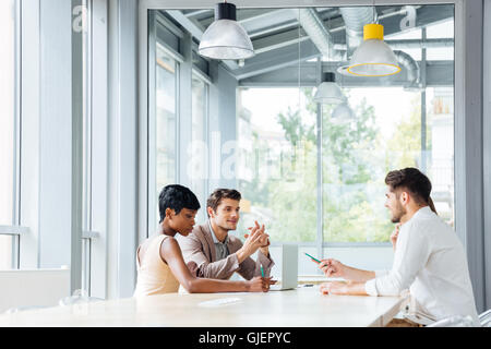 Group of young businesspeople working and brainstorming on meeting in office - Stock Photo