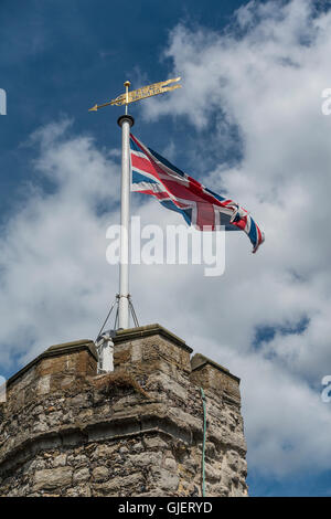 Union Jack Flag Flying in Strong Wind - Stock Photo