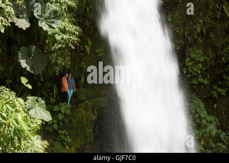 people walking behind a waterfall, La Paz waterfall, Poas, Costa Rica, Central America - Stock Photo