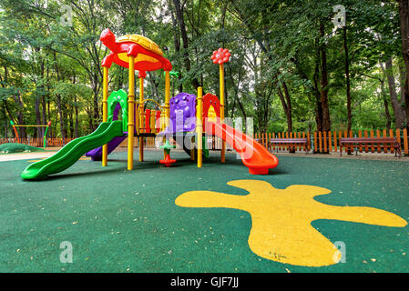 Children playground in the park. Colorful playground in public park. - Stock Photo