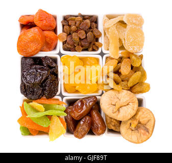 Bowls of various dried fruits - Stock Photo