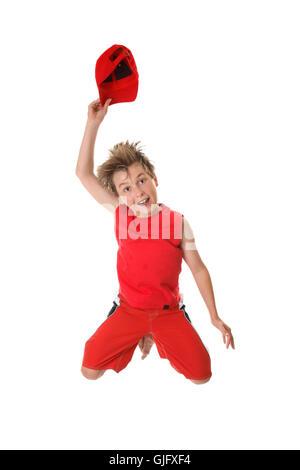Spirited Happy Boy Jumping - Stock Photo
