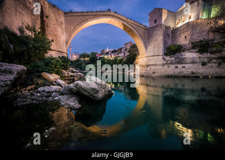 Old Bridge in city of Mostar in Bosnia and Herzegovina, built in 16th century by Ottoman empire - Stock Photo