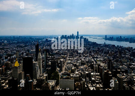 The view from the open 86th floor observation deck on the The Empire State Building looking towards lower Manhattan - Stock Photo