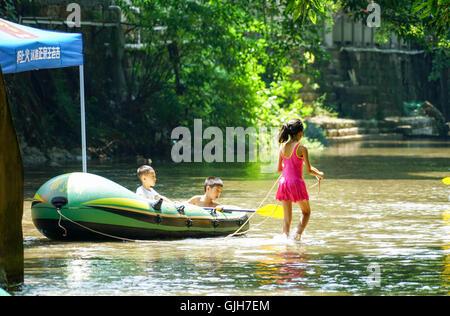 Chongqing, China's Chongqing Municipality. 17th Aug, 2016. Tourists play in Zhuxi River of Pianyan Ancient Town, - Stock Photo