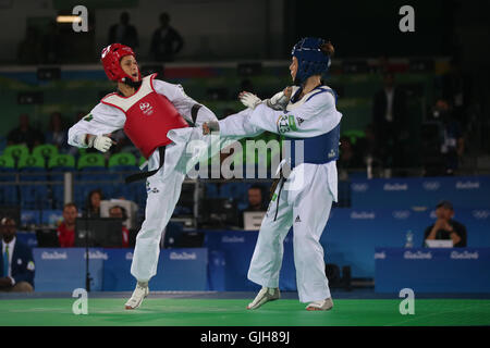 Rio de Janeiro, Brazil. 17th August, 2016. OLYMPICS 2016 TAEKWONDO - Iris (BRA) wins the fight against Kilday (NZL) - Stock Photo