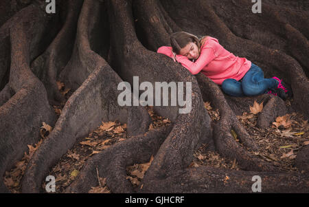 Sleeping Girl Curled Up On A Bed Stock Photo Royalty Free