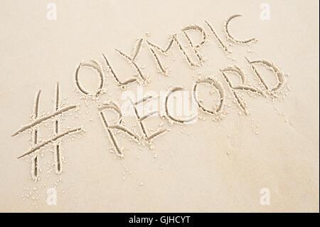 RIO DE JANEIRO - APRIL 4, 2016: Handwritten hashtag Olympic Record social media message handwritten in clean text - Stock Photo