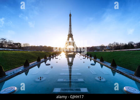 Eiffel Tower reflected in Trocadero fountains at sunrise, Paris, France - Stock Photo