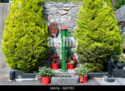 Vintage water-pump in old village in the countryside, Ireland, - Stock Photo