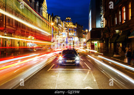 Shaftesbury Avenue in London, UK, at night - Stock Photo