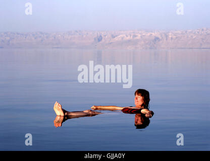 Girl floating at the Dead Sea, Jordan - Stock Photo