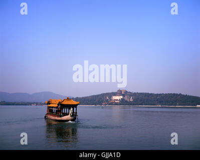Chinese Dragon Boat at the Kunming lake near the Summer Palace in Beijing, China - Stock Photo