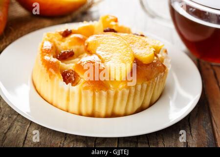 homemade mini apple cake with caramelised apple wedges and raisins. - Stock Photo