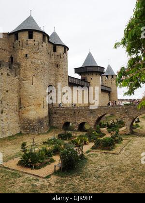 Carcassonne, entrance bridge to the Chateau Comtal castle. Languedoc Roussillon, France - Stock Photo