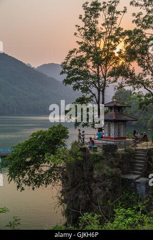 Temple on the lake at sunset in Pokhara, Nepal - Stock Photo