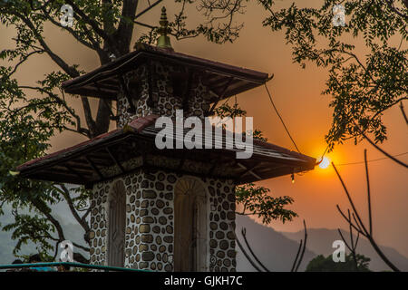 Stone temple at sunset in Pokhara, Nepal - Stock Photo