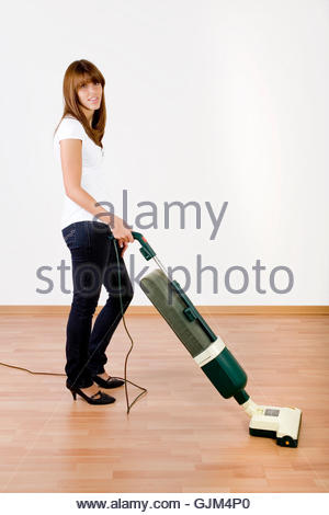 woman playing with vacuum cleaner