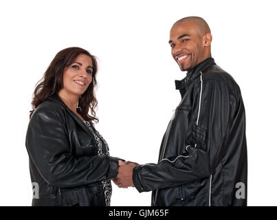 Multicultural couple holding hands and smiling - Stock Photo