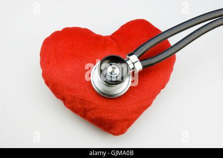 heart stethoscope wiretapping - Stock Photo
