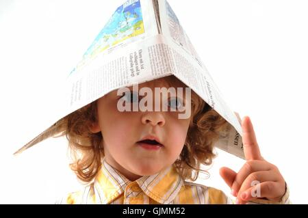 newspaper journal hat - Stock Photo