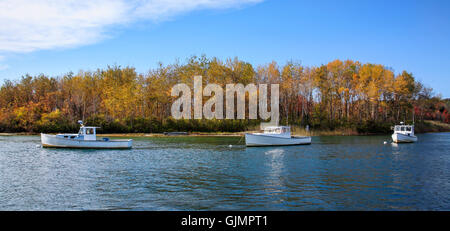 Lobster boats at rest on a sunny autumn morning in Kennebunkport Harbor, Kennebunkport, Maine, USA - Stock Photo