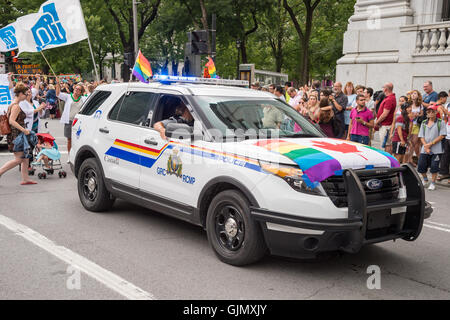 Montreal, CA - 14 August 2016: A car of the Royal Canadian Mounted Police with gay canadian rainbow flags - Stock Photo