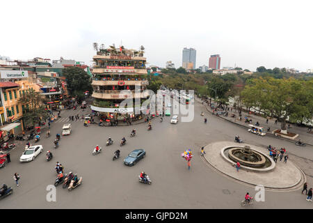 Hanoi, Vietnam - February 23, 2016: Traffic in the old quarter of Hanoi at sunset. View from above. - Stock Photo