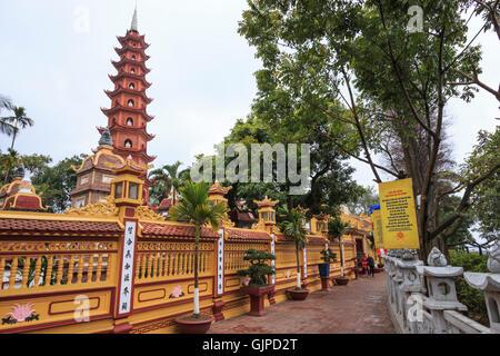 Hanoi, Vietnam - February 23, 2016: Tourists visiting the Tran Quoc Pagoda in Hanoi, Vietnam - Stock Photo