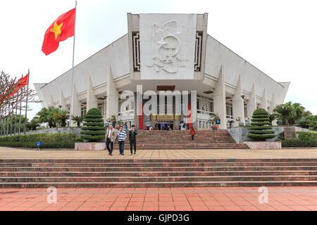 Hanoi, Vietnam - February 23, 2016: Tourists walking around the Ho Chi Minh Museum in Hanoi, Vietnam. - Stock Photo