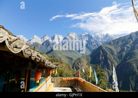 View of the Jade Dragon Snow Mountains from the terrace of Naxi Family Guest House, Tiger Leaping Gorge, Yunnan, - Stock Photo