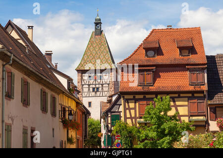 Half-timbered clock tower in Bergheim, Alsace France - Stock Photo