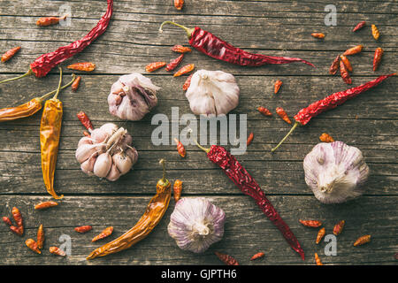 Garlic and chili peppers on old wooden table. Top view. - Stock Photo