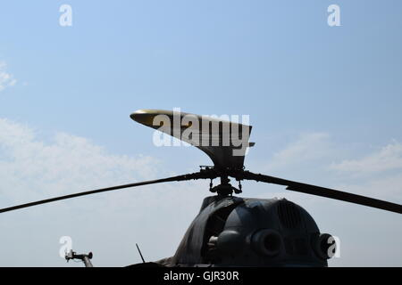 Old helicopter spraying fields. Helicopter spraying fertilizer. - Stock Photo
