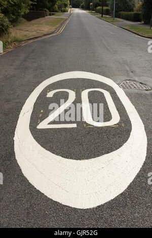 Close up wide angle view of 20 miles per hour mph speed limit signs painted on a road in Cambrudge UK - Stock Photo