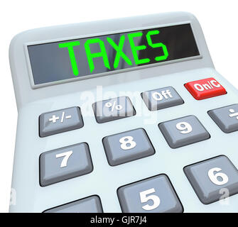 Taxes - Word on Calculator for Tax Accounting - Stock Photo