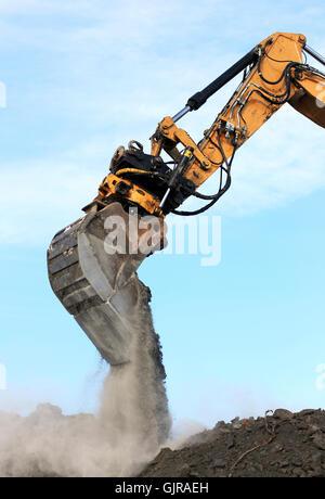 bucket dirt arm - Stock Photo
