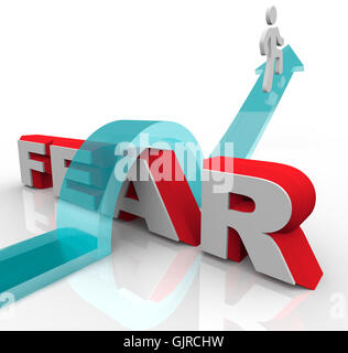 Conquering Your Fears - Jumping Over Word to Beat Fear - Stock Photo
