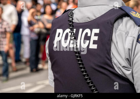 Montreal, CA - 14 August 2016: Back of the bulletproof vest of a Royal Canadian Mounted Police sergeant - Stock Photo
