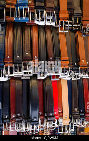 Italian leather belts for sale at Loggia del Mercato Nuovo, Florence, Tuscany, Italy - Stock Photo