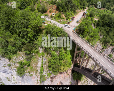 Road passing through the village on the one side of Tara river canyon. The Durdevica bridge connects other side. - Stock Photo