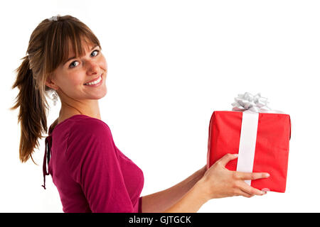 pretty young woman holding a present - Stock Photo