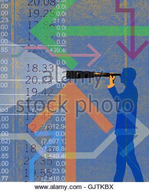 Businessman looking through telescope analyzing financial figures - Stock Photo